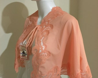 1960's vintage lace trimmed bed jacket in peach free size with tags made in France