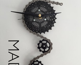 Triple Sprocket and Jockey Wheel Clock, depicting a bike derailleur and cassette, in Black and Grey