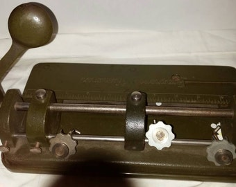 Vintage Cast Iron 3 Hole Paper Punch. Improved Hummer. Felt Bottom. Weighs 7.10# Before Packaging