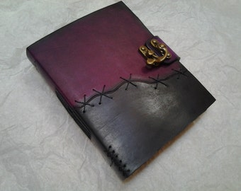 purple and black leather journal
