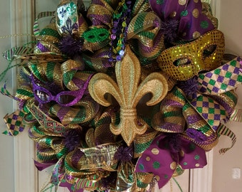 "Mardi Gras Wreath made of deco mesh, ribbons, masks and beads. 24"".."
