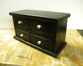 Four drawer apothecary table or counter cabinet.