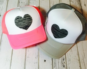 New gray woven heart trucker hat. Choose from a variety of different hat colors and sizes, see description for sizing