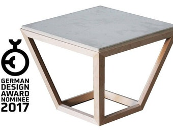 cretable | Hangefertigter Designer table made of concrete and wood