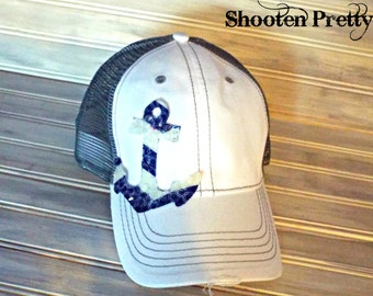 Gray and White trucker hat with navy and white chevron anchor