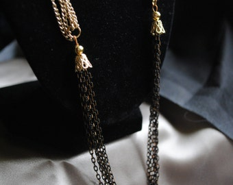 Multi strand black and gold chain necklace