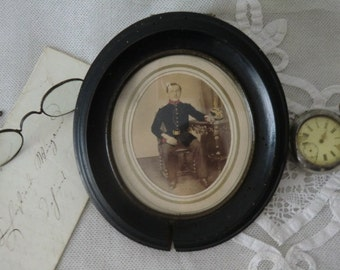 Vintage antique picture frame oval with men portrait to 1843 military dark shabby