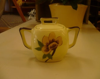 Yellow Sugar Bowl with Brown Accents and Flower Decoration