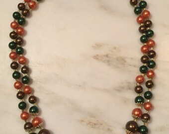 Vintage Japan double strand plum orange and green beaded necklace