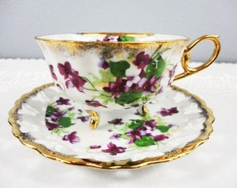 LM Royal Halsey Violets Tri-Footed Lusterware Fine China Teacup and Saucer