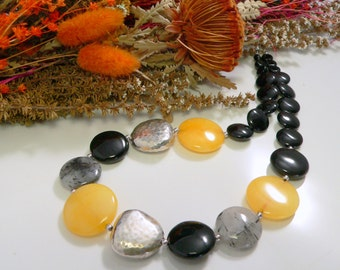 Yellow Rabbit Jade, Black Onyx and Tourmalinated Quartz with Sterling Silver Findings.