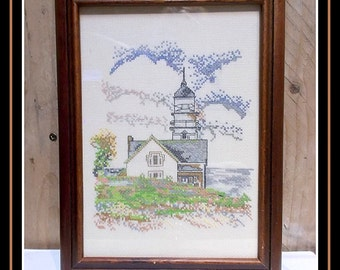 Vintage embroidery in wooden frame. Lighthouse / nautical theme.