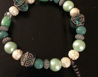 Jade colored beaded bracelet