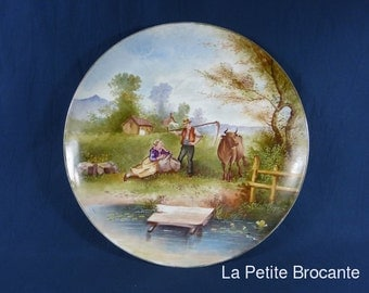 Round Dish porcelain with decoration of peasant scene