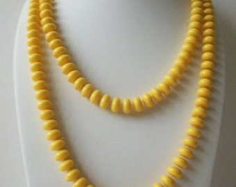 ON SALE Vintage 1970s Long Vibrant Yellow Plastic Beads Necklace 81916