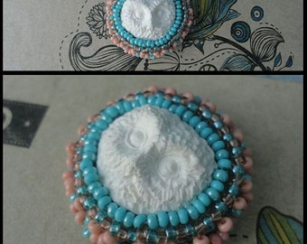Brooch. White Owl. Beads, modeling.