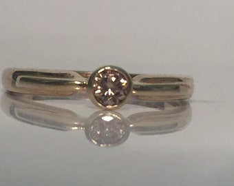 Diamond solitaire ring in 9ct gold
