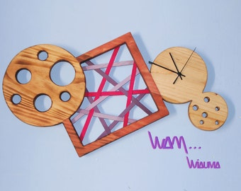 Design wall clock in solid wood