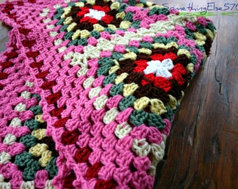 Pink and variegated colored baby afghan or lap blanket for those who get cold.  Also would dress up any room in cozy way.