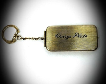 vintage charge plate keychain brass textured metal hard case with red interior