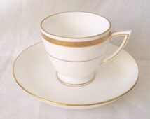 Minton Tea Cup and Saucer Harlequin Set in Gold - G9816 with Gold Monarch Saucer 1963 Mintons