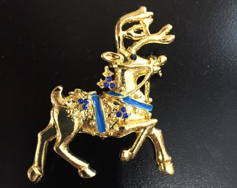 Gold Tone Reindeer Brooch With Blue Rhinestones