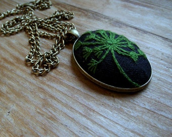 Pendant with hand embroidered dandelion