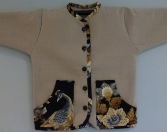 Child's jacket with bird/floral trim on pockets