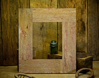 8×10 Rustic Faded Barn Wood Siding picture frame. This picture frame is made from a faded red reclaimed barn wood siding.