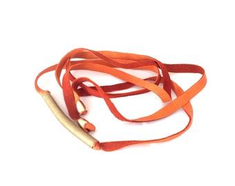 Deerskin leather wrap belt with raw brass in rust