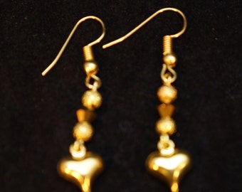 Gold hearted earrings