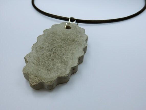 Necklace Leaf form concrete jewelry on black leather strap unique concrete on silver colored rings concrete jewelry grey black stone Jewelry