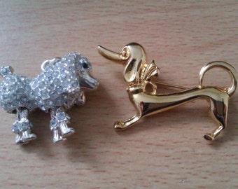 1 dog brooch and 1 dog pendant