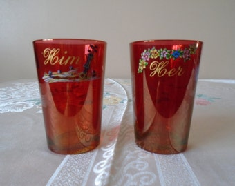 Her and Him cranberry glass tumblers with designs.
