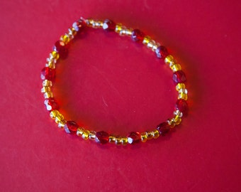 red and gold elastic bracelet