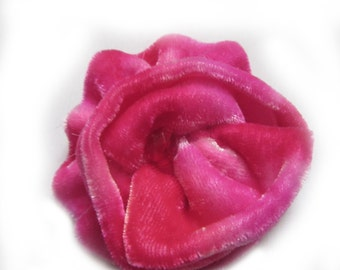 Different shades of pink silk velvet fabric flower corsage brooch with added red crystal bead, ideal for a valentine gift.