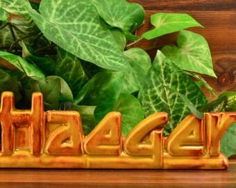 Haeger Pottery Dealer Sign in Golden Brown
