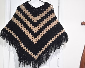 Woman's black and khaki poncho size med.-extra large . Extra long for the taller lady.
