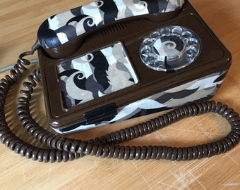 Old phone to dial vintage, old phone retro antique roulette of wall with fabric Brown mustache