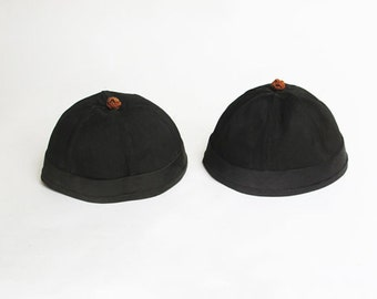 pair of antique chinese hats skull caps vintage fashion