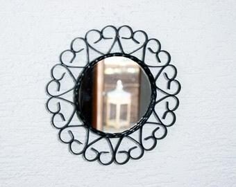 Small metal mirror