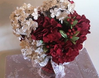 Elegant centerpiece with red and cream hydrangea's in a white vase