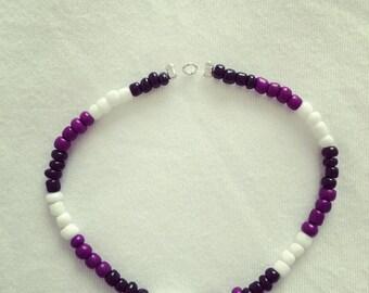 Purple, black and white stretchy bracelet