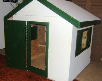 Childrens' indoor/outdoor playhouse made with wood
