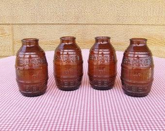 """Set of 4 vintage """"Barrel of Beer"""" glass jars"""