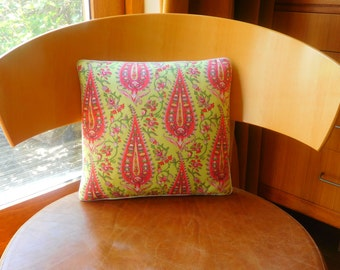 Pink and yellow abstract floral cushion.  Vintage style pink and yellow abstract floral cushion. Paisley print cushion in pink and yellow.