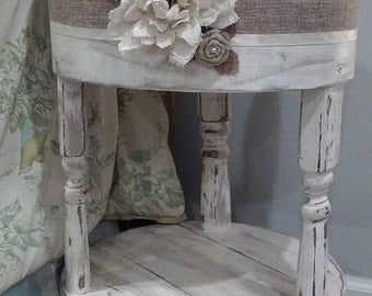 White accent table. round or oval.