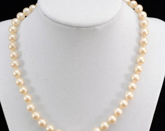 Vintage Neutral Pink Pearl Necklace.. Knotted...J345