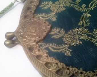 Brocade purse, metal and cloth
