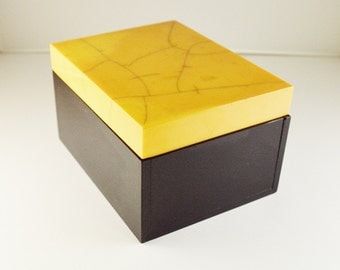 Yellow Bakelite and black plexiglas box